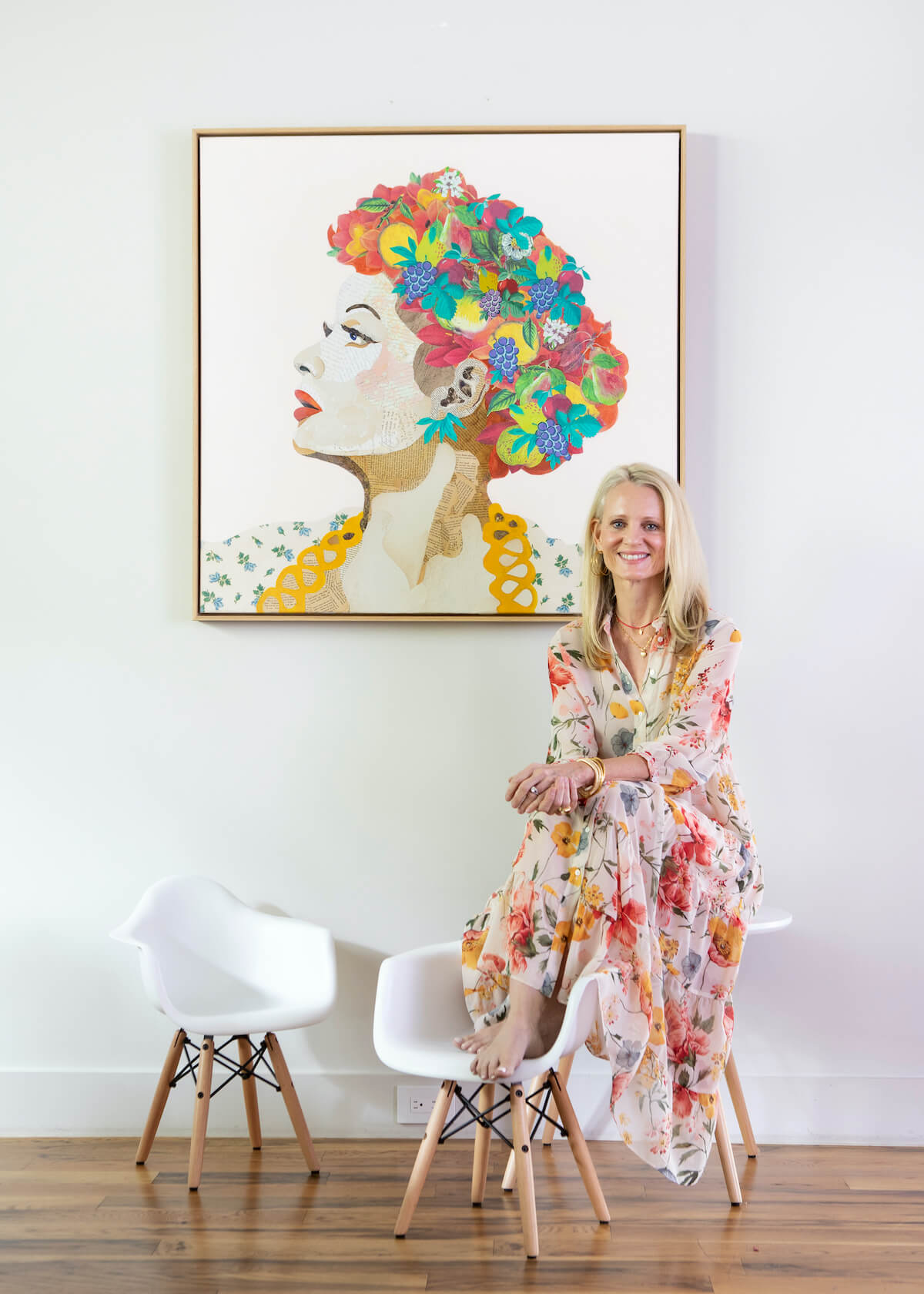 Brenda Bogart sitting in front of her Lucy piece featuring I Love Lucy collage